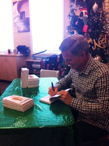 Terry signing a book
