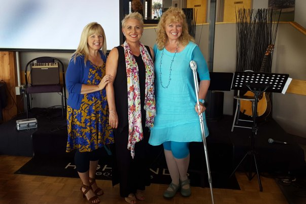 "Paula Drew, Marie Bridge and Laura Bachynski about to sing "" I'll Fly Away """
