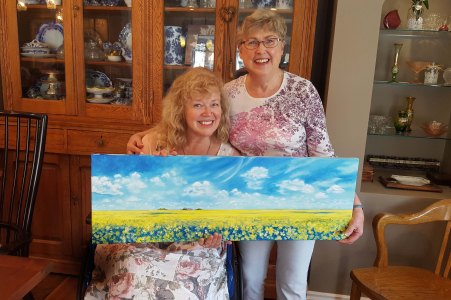 Presenting Canola Field painting to its new owner